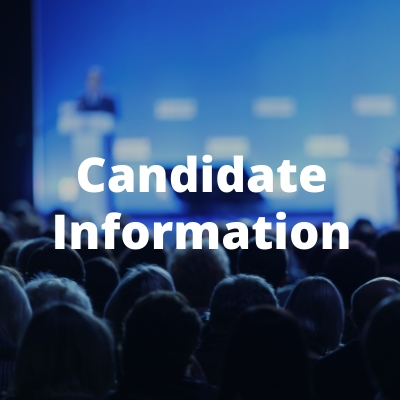 Candidate Information: Person at a podium in front of a crowd