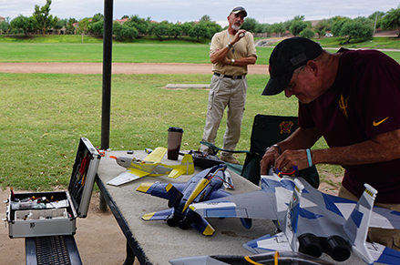 Flyers work on RC planes and share stories