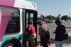 people boarding bus