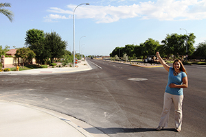 woman standing in completed street