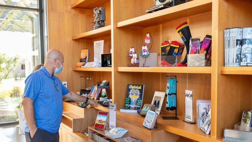 Man Browsing at the Chandler Museum Store