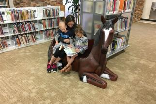 family reads together in library