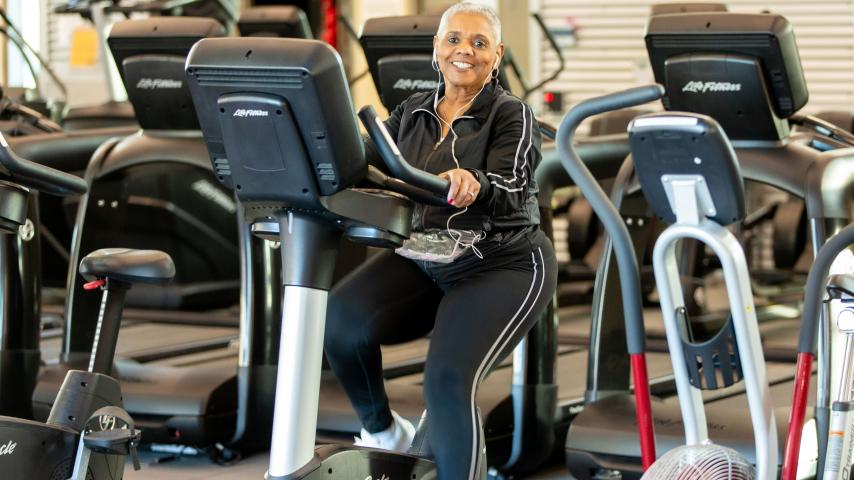 active adult on fitness equipment