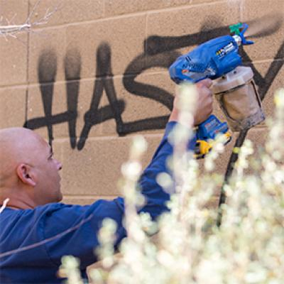 Chandler employee removing graffiti
