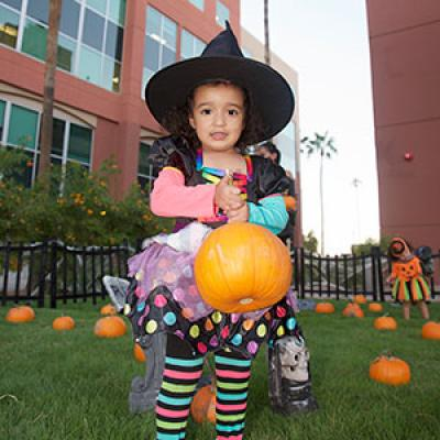 Halloween Spooktacular Girl with Pumpkin