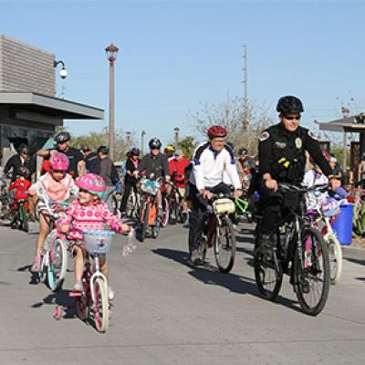 A Family Riding with Chandler Police at the Chandler Family Bike Ride