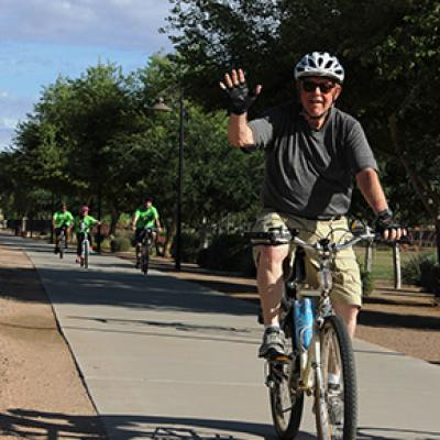 Cyclist Waving During the Chandler Family Bike Ride