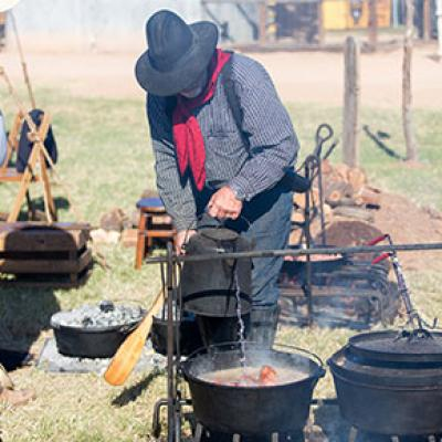 Tending to a campfire meal at the 2017 Chuck Wagon Cookoff