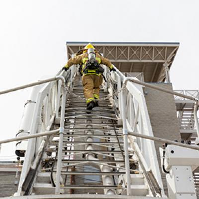 Chandler Firefighter climbing ladder truck
