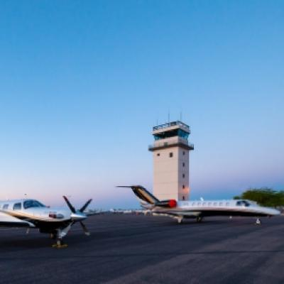 Two Private Jets Sitting in Front of the CHD Tower