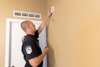 Chandler Fire testing a resident's smoke alarm