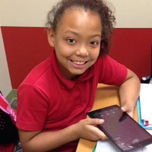 Throughout their year in ASPIRE Read to Succeed, students work on a tablet to play educational games and practice literacy skills they'll use in school.